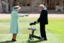 Captain Sir Tom Moore receives his knighthood
