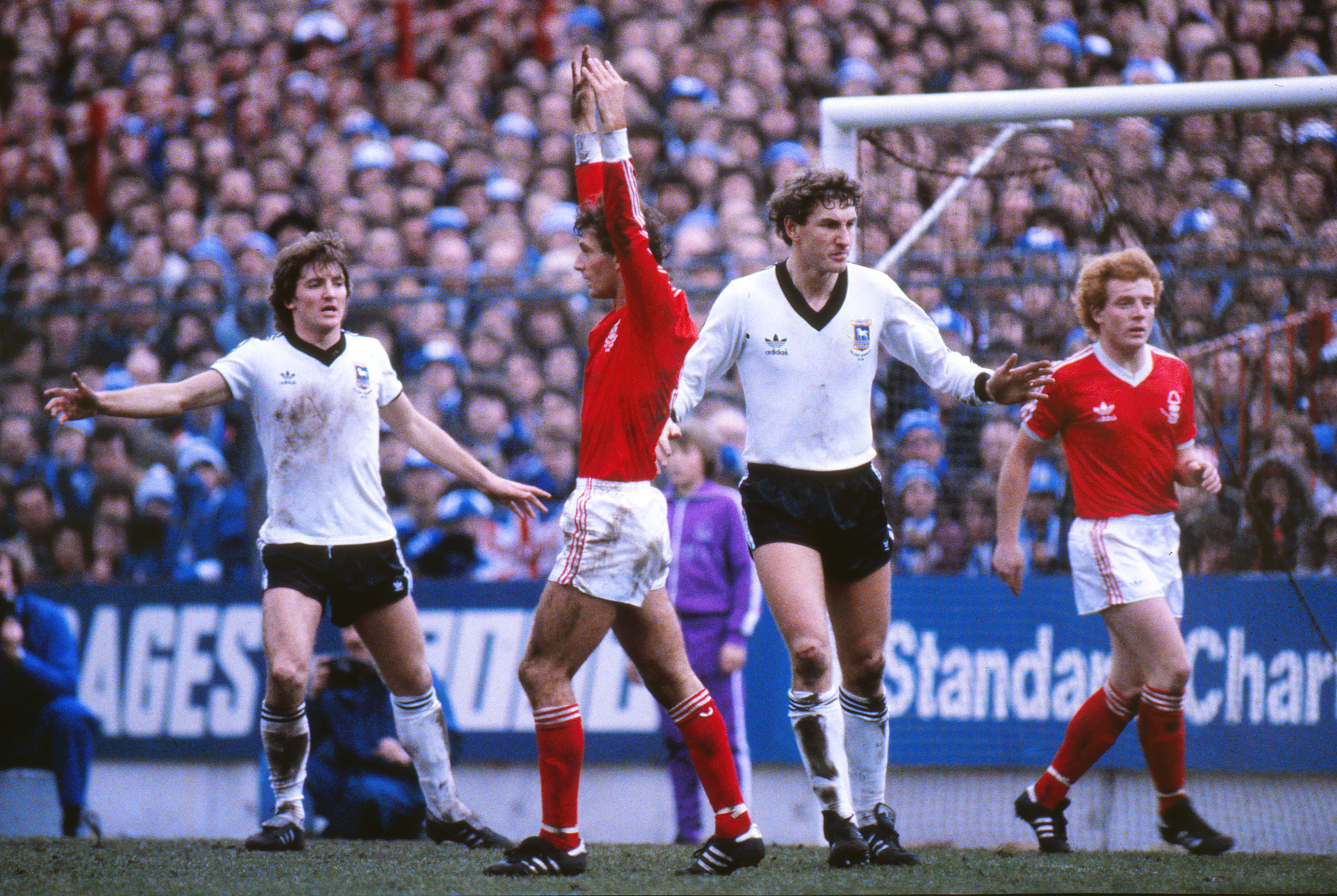 Russell Osman and Terry Butcher up against Nottingham Forest's Trevor Francis and Ian Wallace in 1981