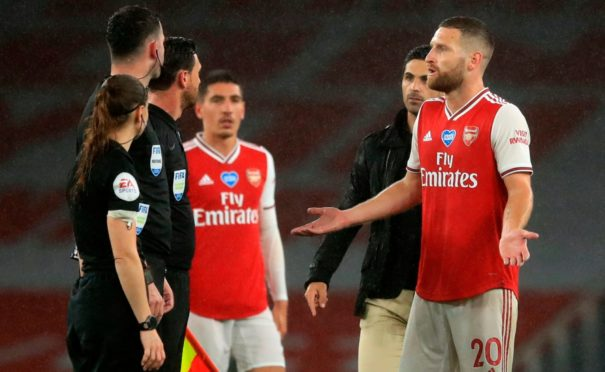 Arsenal boss Mikel Arteta and his players take issue with the officials at Leicester