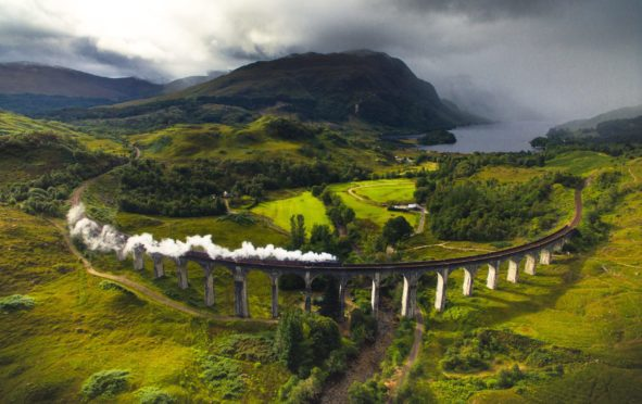 A steam train crosses the famous Glenfinnan Viaduct
