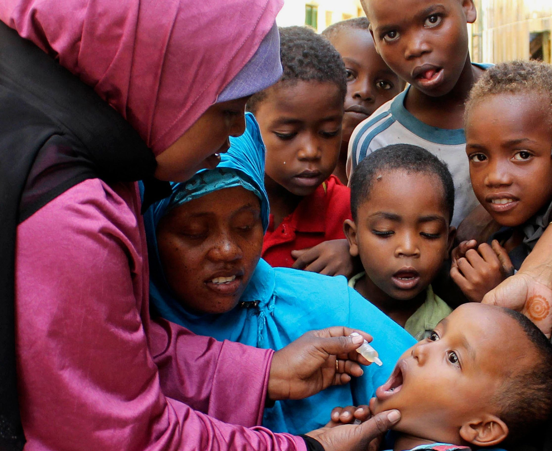A child is given a polio vaccine in 2013 in Somalia, a country now poliovirus free