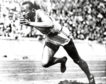 Jesse Owens competes in one of the heats of the 200-meter run at the 1936 Olympic Games in Berlin