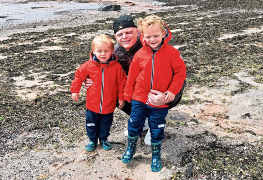 Alisdair Cameron with his two boys, Leo and Joe