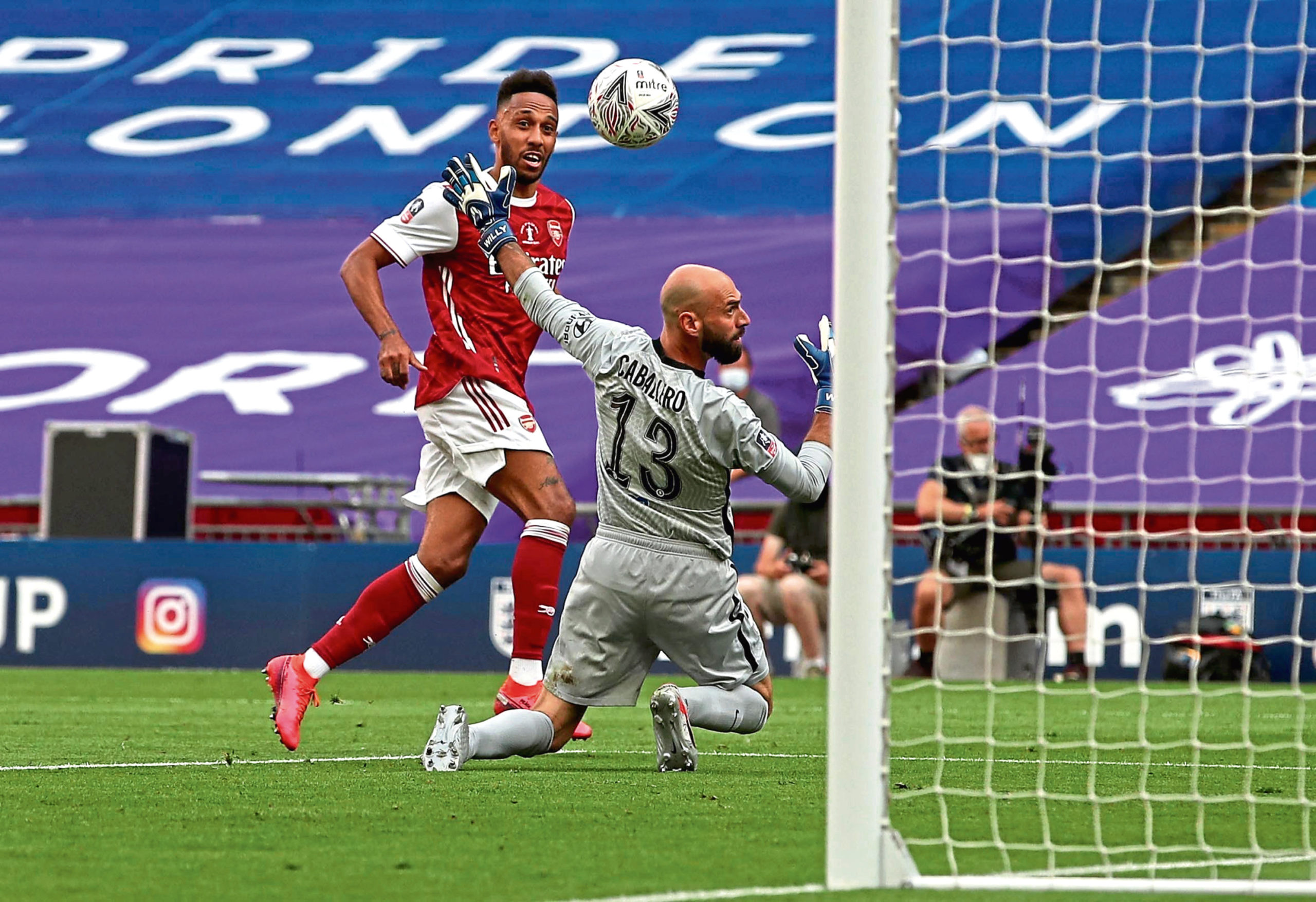 Pierre-Emerick Aubameyang cooly clips the ball over Chelsea keeper Willy Caballero for his second goal of the match