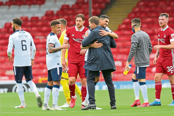 Smiles all round at Pittodrie as Steven Gerrard congratulates Leon Balogun on his debut