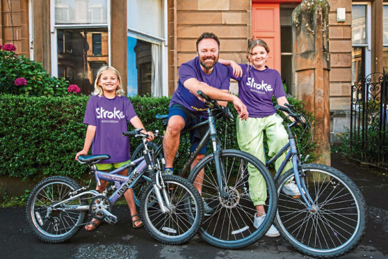 Stephen and daughters Elsa and Thea who are cycling to raise funds for the Stroke Association