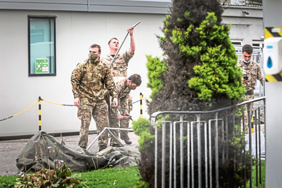 Soldiers erect a tent at the 2 Sisters food plant in Coupar, Angus to conduct Covid testing