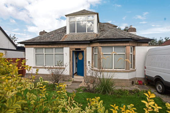 The Edinburgh bungalow raided by police