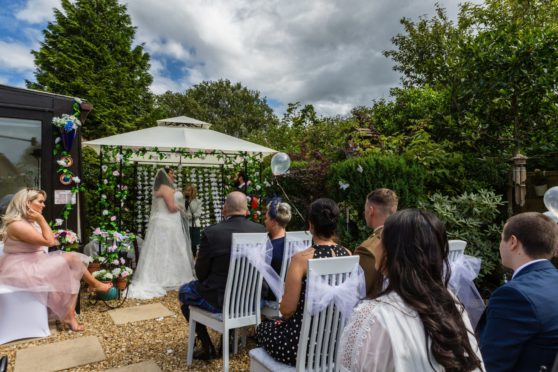 Rebekah and Matt take their vows in front of guests in her gran and grandad's back garden