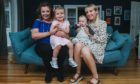 Shona Brown, left, and three-year-old daughter Mara meet Laura Boyd and her nine-month-old                              daughter Penelope for the first time in person at Laura's home in Glasgow