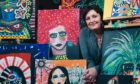 Daniela Nardini with some of her paintings