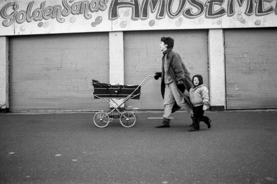 Graham took this picture of an unknown family in Portobello in 1987. The baby in the pram, Kirstyn Cameron, discovered the photo of herself, mum Mary Jane and big brother Matthew on a Facebook group