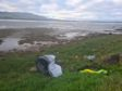 Rubbish left by tourists at Loch Fleet.