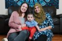 Nosheen Nazer and son Abdul, with doula Amanda Purdie, left, at home in Maryhill.
