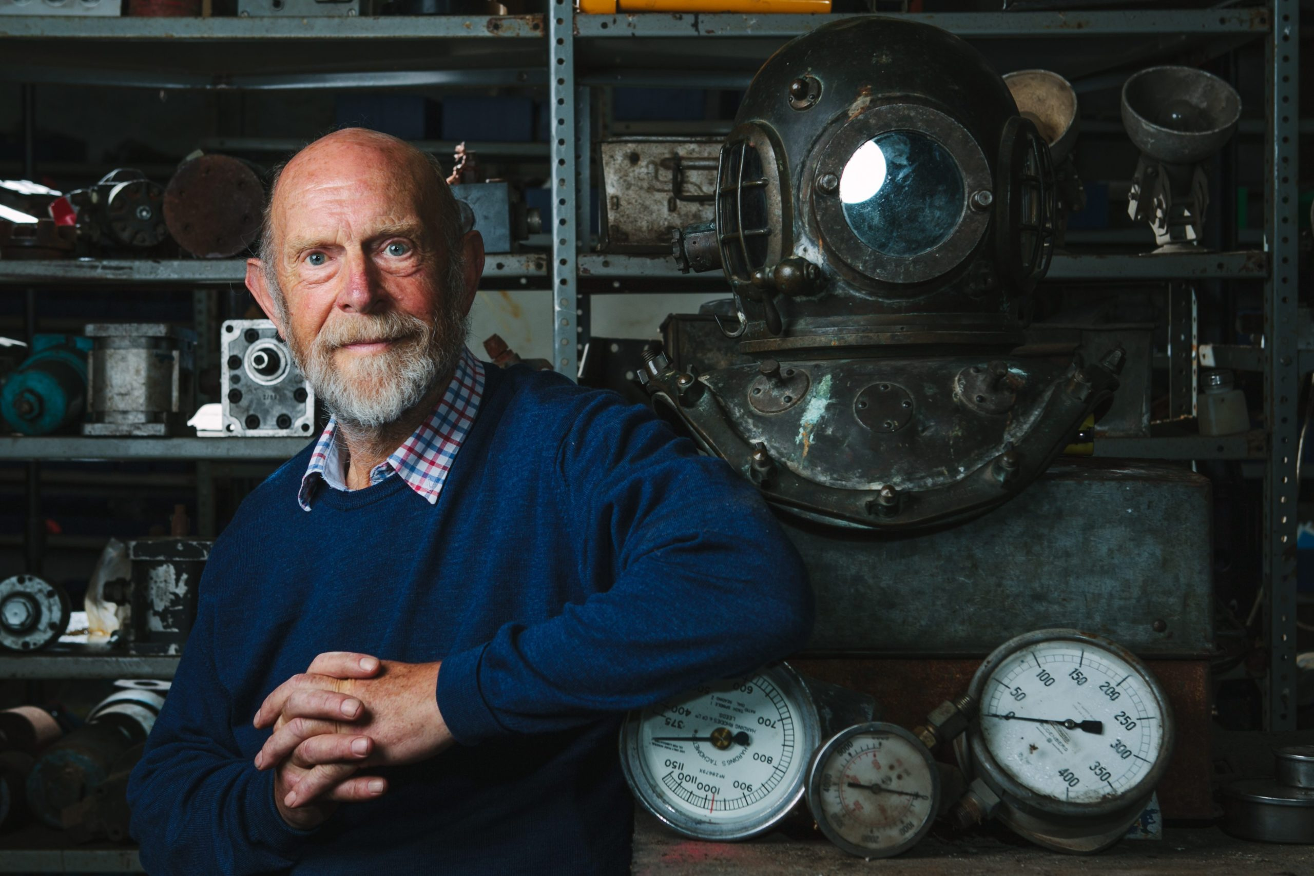 Salvage expert Alec Crawford at home in Newport-on-Tay, Fife, with artefacts from his dives