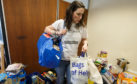Selina Hales organises food deliveries inside a disused office block in Glasgow