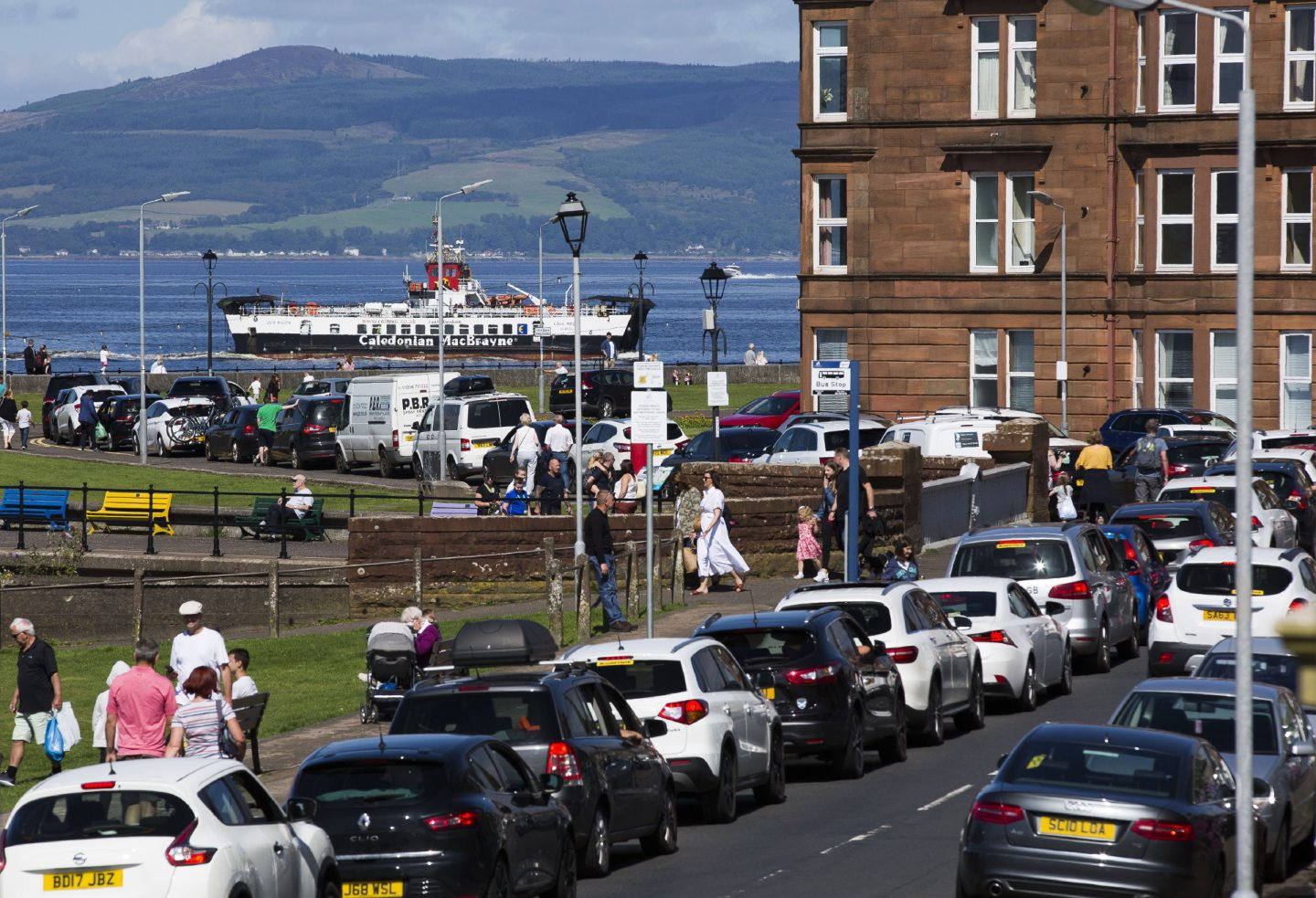 Day trippers queue in Largs for the Isle of Cumbrae, Millport ferry as temperatures rise on the weekend before the kids finally go back to school.