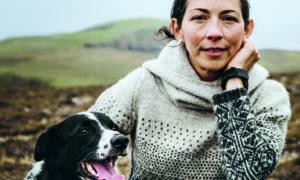 Fair Isle knitwear designer and author Mati Ventrillon with faithful sheepdog Lola