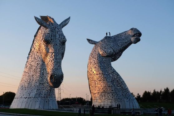 A picture circulating on social media shows two people on top of one of the Kelpies