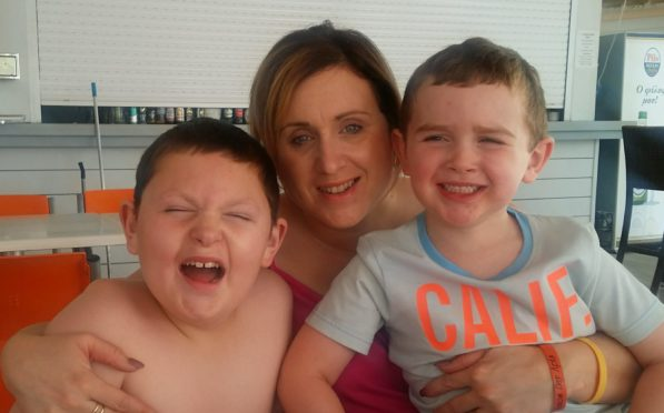 Stacey McPherson with Calum (left) and his younger brother Jack
