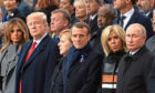 First lady Melania Trump, U.S. President Donald Trump, German Chancellor Angela Merkel, French President Emmanuel Macron and Brigitte Trogneux and Russian President Vladimir Putin.