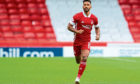 Aberdeen's Shay Logan in action