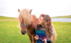 Catherine Munro who is writing a PhD on Shetland ponies. With 'Merkisayre Skerry', a 10yr old Stallion.