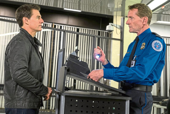 Author Lee Child enjoying a cameo appearance with Tom Cruise in 2016 movie Never Go Back, based on his book