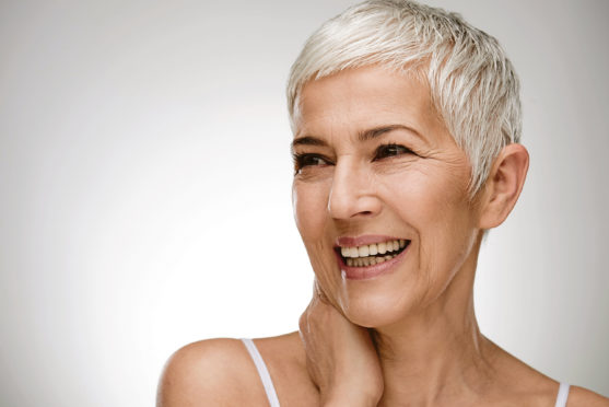 Portrait of beautiful senior woman in front of white background.; Shutterstock ID 1025380411; Purchase Order: -