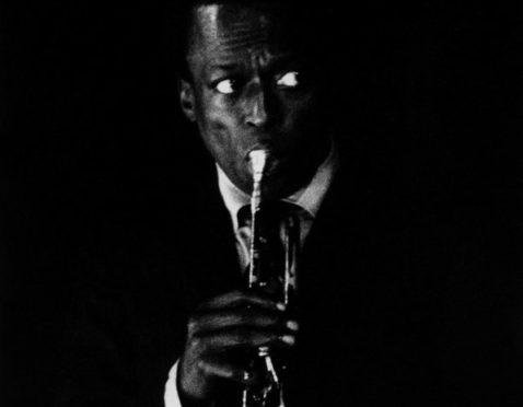 Miles Davis performing in Paris, France in 1967.