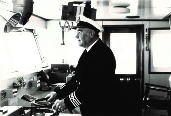 Captain Robin Hutchison at the helm