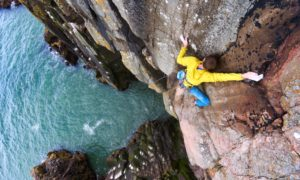 Guy Robertson climbs Orbital Ejection at Red Hole, Cove, Aberdeen