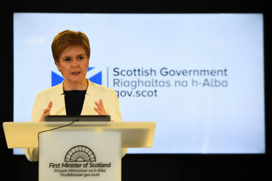 """Scotland's First Minister Nicola Sturgeon said she would not hold people """"like cattle in a pen"""" as reports say remote Scottish islands are being considered to process asylum seekers."""
