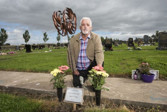 Larry Cullen at his mother Yvonne's grave at Pitkerro Grove Cemetery Dundee. She died after contracting Covid-19.