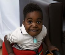 The smile that says I'm home: Little boy leaves hospital after winning two-year fight for life