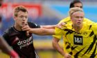 George Johnston gets one in the face from Erling Haaland during Feyenoord's 3-1 friendly win over Borussia Dortmund three weeks ago
