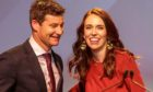 New Zealand Prime Minister Jacinda Ardern (R) and her partner Clarke Gayford celebrate at the New Zealand Labour party election night event in Auckland.