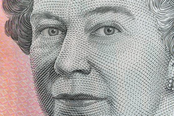 A close-up of the Queen on an Australian five dollar bill