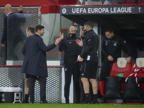 Steven Gerrard and his backroom team enjoy the win in Liege, which was rounded off by Kemar Roofe's brilliant goal