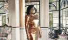 Dame Shirley Bassey, 83, wearing a matching face mask and sequined gold gown during a photo shoot in Italy for her forthcoming new album 'Owe It All To You'
