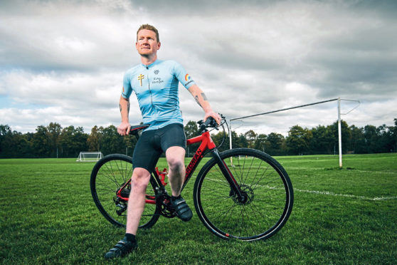 Football fan and fundraiser Stephen Kirley in his Coatbridge home town with his trusted Boardman bike.