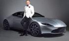 Daniel Craig with an Aston Martin DB10 as James Bond.