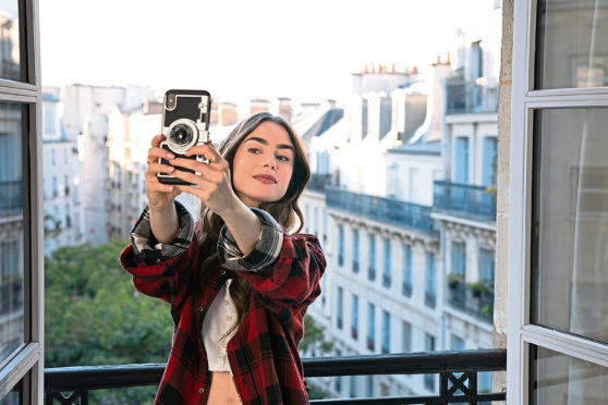 Lily Collins in Emily In Paris, which sadly riffs on the crudest stereotypes