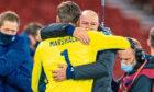 Boss Steve Clarke hugs spot-kick hero David Marshall on Thursday night