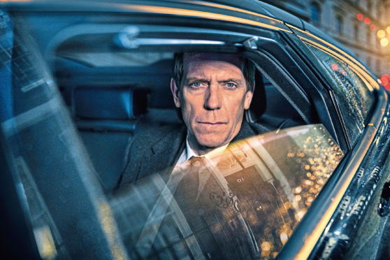 Hugh Laurie as up-and-coming MP Peter Laurence in political thriller Roadkill