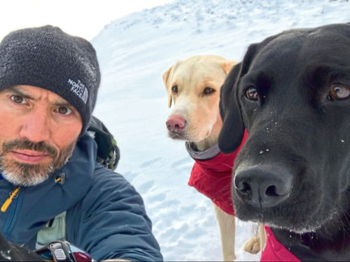 Andrew Cotter with his dogs.