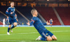 Lyndon Dykes celebrates his goal against Slovakia, but his club manager, Mark Warburton, was unhappy with his amount of game time for Scotland.
