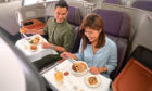 A couple sit down to their in-flight meal on board an A380 Airbus – but they're going nowhere.