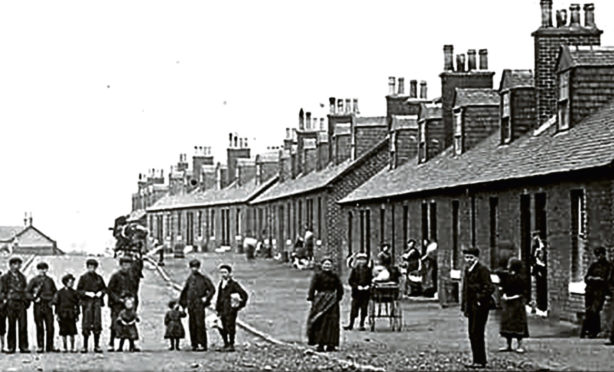 Villagers outside the cottage homes, known as raws, like the one Jock Findlay lived in, in Oakbank, East Calder in 1910