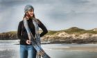 A model wears chunky knit anchor hat and scarf by Herring Girl Knitwear